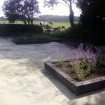 terras bestrating koppelstone bloembak